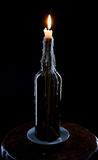 A candle burns in the bottles Royalty Free Stock Image