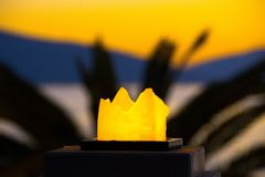 The candle burns. Evening, sunset. Burning candle in the evening at sunset Royalty Free Stock Photography