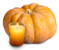 The candle burns and pumpkin on white background Stock Image