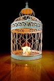 Candle in a cage Royalty Free Stock Image