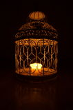 Candle in a cage Stock Photo
