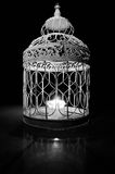 Candle in a cage Stock Photography