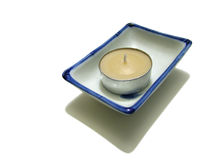 Candle and Candle Holder. Candle in a candle holder on white background royalty free stock photo