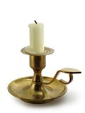 Candle within candlestick. Candle within bronze candlestick isolated over white background stock images