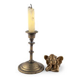 Candle with a candlestick and an angel Stock Images
