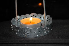 Candle in a candlestick. Bright gorit. yellow flame, lighting the room romantika.na nintendo background stock photos