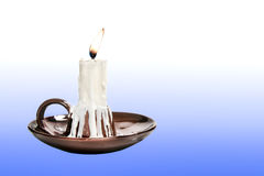 Candle in candlestick brown. On a gradient background Stock Photos