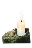 Candle in a candlestick. Burning candle in a candlestick from serpentinite Stock Photos