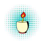 Candle in a candlestick icon, comics style. Candle in a candlestick icon in comics style on a white background Stock Photography