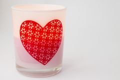 Candle in a candlestick on a white background Royalty Free Stock Images