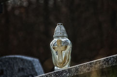 Candle. Cemetery glass candle with cross Stock Images