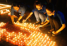 Candle in ceremony. HO CHI MINH CITY , VIETNAM- JULY 26: People hold candle in July 27 event, ceremony to commenorate heroic that sacrifice in Vietnam war at Stock Image
