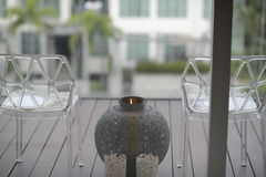 Candle between chairs Stock Photography