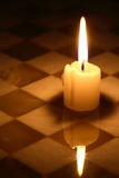 Candle On Chessboard Stock Images