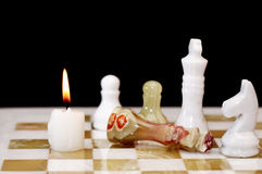 Candle On Chessboard Stock Photo