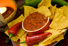 Candle, chips, salsa, peppers Royalty Free Stock Photos