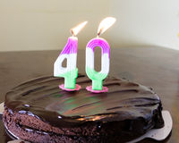 40 candle on chocloate birthday cake Stock Image