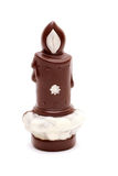 Candle of chocolate. White background Royalty Free Stock Photo