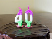 40 candle on chocolate birthday cake Royalty Free Stock Photos