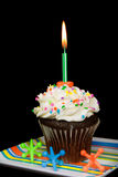 Candle in chocolate cupcake Royalty Free Stock Image