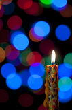 Candle and Christmas background Stock Image