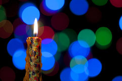 Candle and Christmas background Royalty Free Stock Photos
