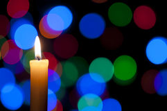 Candle and Christmas background Stock Photos