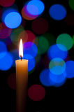 Candle and Christmas background Stock Images