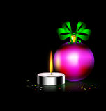 Candle Christmas ball. Black background and burning candle with Christmas ball Royalty Free Stock Image