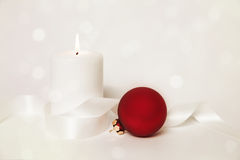 Candle and christmas ball Stock Image