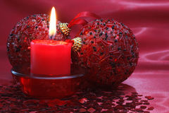 Candle and christmas balls. Royalty Free Stock Photography