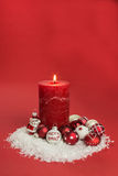 Candle with christmas baubles Royalty Free Stock Image