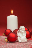 Candle with christmas baubles Royalty Free Stock Photo