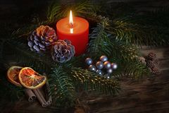 Candle with christmas decoration Stock Photos