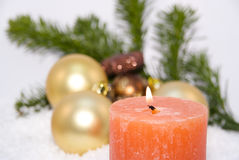 Candle with Christmas decoration Stock Image