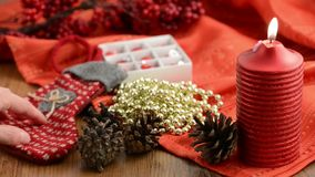 Candle with Christmas decoration around like Christmas balls, pearls, pine cone. Candle with Christmas decoration around like Christmas balls, pearls, pine cone stock video