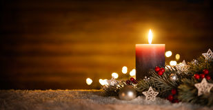Candle and Christmas decoration with wooden background stock images