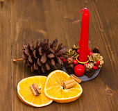 Candle with Christmas decorations close Royalty Free Stock Photography