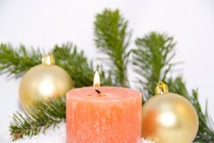 Candle with Christmas ornaments Royalty Free Stock Photo