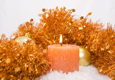 Candle with Christmas ornaments Stock Photos