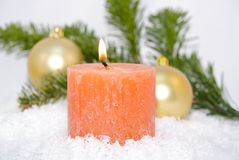 Candle with Christmas ornaments Royalty Free Stock Image