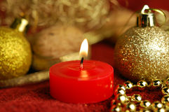 Candle and christmas ornaments Royalty Free Stock Photos