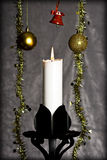 Candle and Christmas ornaments Stock Image