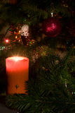 Candle and christmas-tree decorations Stock Photos