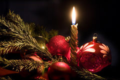 Candle and christmas-tree decorations stock photography