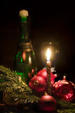 Candle and christmas-tree decorations. On a black background Royalty Free Stock Photography