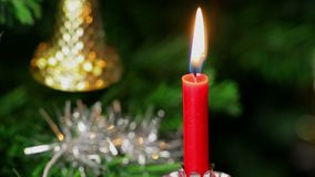 Candle on Christmas tree stock video footage