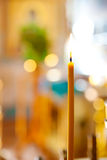 Candle in a church Stock Images