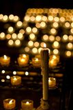 Candle in church. Candle burn in dark church Royalty Free Stock Photos