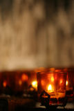 Candle in a church. Votive prayer candles in St. Patrick's Cathedral, New York, NY Royalty Free Stock Images